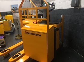 Used Jungheinrich ERE 225 Stand On Electric Pallet Truck